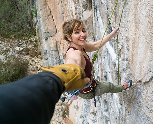 Climbing picture of MAXIM athlete Colette McInerney