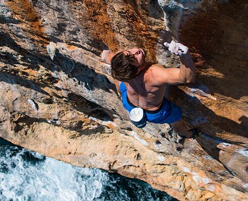 Climbing picture of MAXIM athlete Greg Kerzhner